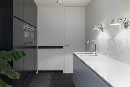 A white kitchen renovation example picture.